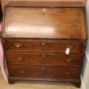 An 18th century oak bureau W.92cm