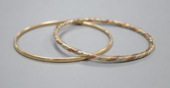 A 9ct three-colour gold bangle and another 9ct yellow gold bangle.