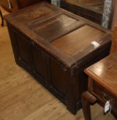 An early 18th century panelled oak coffer W.105cm