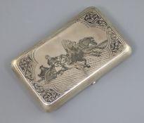 A late 19th century Russian 84 zolotnik silver and niello cigarette case, decorated with troika