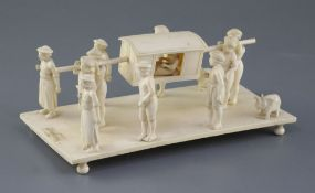 A 19th century Indian carved ivory group of a nobleman being carried in a sedan chair, attended by