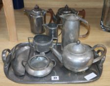 A Tudric hammered pewter tea set including tray, a 'period pewter' 3 piece tea set crumb scoop and