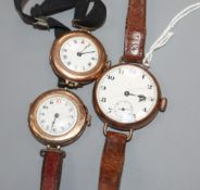 A 9ct gold trench watch and two similar smaller watches