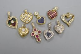 Nine assorted modern gem set pendants, one 18ct gold, seven yellow metal and one white and yellow