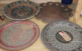 Three Middle Eastern metal ware trays and a Chinese porcelain bowl