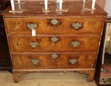 An 18th century and later walnut three drawer chest (formerly the base of a tallboy) W.100cm