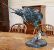A 20th century bronze of a leaping sailfish on marble, circular plinth height 54cm