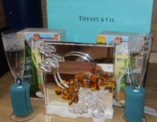Tiffany glasses, a Swarovski ornament and a pair of Dartington glasses
