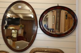 Two oval wood framed wall mirrors, together with an oval gilt framed wall mirror (3) Largest 82cm