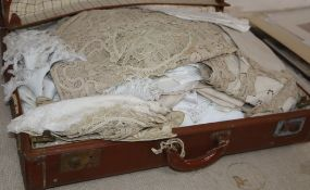 A large collection of hand worked crochet linens in a trunk