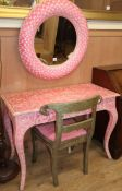 A brightly painted pink and white dressing table, a similar circular wall mirror and a silvered