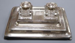 A large George silver desk stand fitted two ink bottles, London 1927, Mappin & Webb, 31.5cm, stand