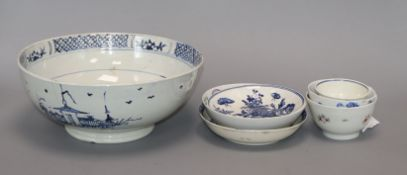 A Liverpool Delft blue and white bowl, decorated buildings and trees and three early tea bowls