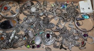 A mixed quantity of silver and other jewellery, including charm bracelets, bangles etc.