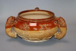 A 19th century Lambeth stoneware bowl, with three 'lion' handles height 12cm