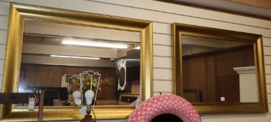 A pair of rectangular gilt framed wall mirrors W.108cm
