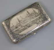 A late 19th century Russian 84 zolotnik silver and niello cigarette case, decorated with view of Red