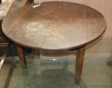 An 18th century oak circular topped cricket table (cut down) Diameter 83cm