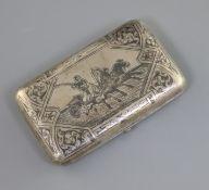 A late 19th century Russian 84 zolotnik silver and niello cigarette case, decorated with scene of