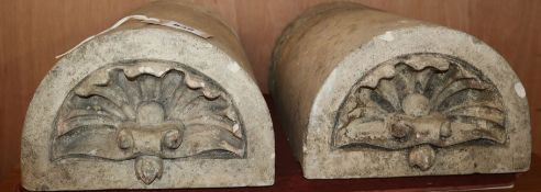 A pair of reconstituted stone D shaped appliques W.41cm