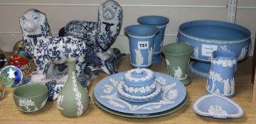 A collection of thirteen pieces of green and pale blue Wedgwood jasper pottery and a pair of ceramic