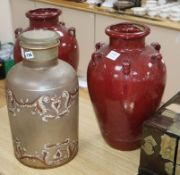 A Victorian black painted opaque glass jar and cover, together with a pair of red glazed