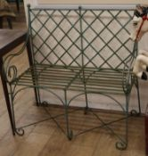 A green painted slatted wrought iron bench L.91cm