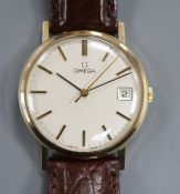A gentleman's yellow metal Omega manual wind wrist watch, with date aperture, on later associated