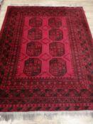 An Afghan carpet 195 x 150cm