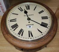 Elliott, London. A faded mahogany fusee wall clock diameter 48cm