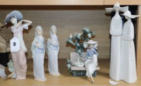 Lladro figurines: nuns, seated girl on a bench with basket and doves and flower girl (5)