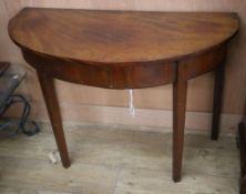A George III mahogany D shaped side table W.100cm