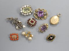 Two early 20th century amethyst brooches, five other brooches including Victorian garnet and