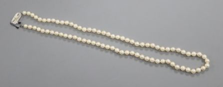 A Mikimoto Akoya cultured pearl single row necklace, with 79 uniform pearls and silver pearl-set