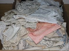 A collection of coloured embroidered table linen, a 1950's evening dress with Chinese motifs and