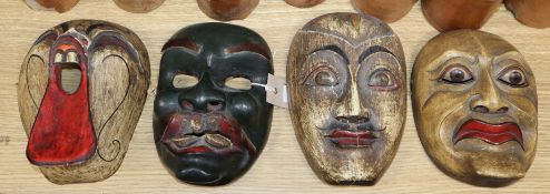 Four Chinese painted carved wood masks