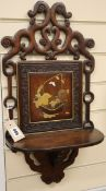 A Chinese lacquered hardwood wall bracket W.31cm
