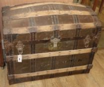 A Victorian brass studded, ash bound domed topped leather trunk