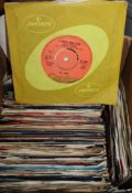 A collection of 1950's and later 45rpm vinyl single records, including Beatles, T-Rex, etc.