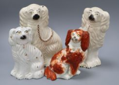 Four Staffordshire pottery figures of spaniels