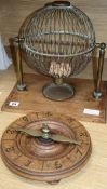 A late 19th century/early 20th century brass tombola cage and an early roulette wheel