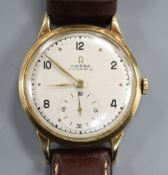 A gentleman's 1940's 9ct gold Omega Automatic wrist watch, with subsidiary seconds, movement c.