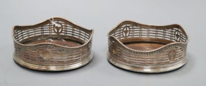 A pair of early 19th century silver plated bottle coasters diameter 13cm