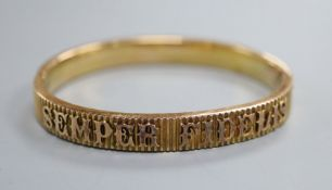 A yellow metal hinged bangle, inscribed 'Semper Fidelis'.
