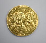 A Byzantine histamenon gold coin.