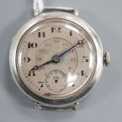 A gentleman's early 20th century white metal Omega manual wind wrist watch, with Arabic dial and
