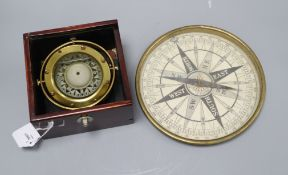A marine compass on brass gimbal mount in mahogany case and a brass surveyor's compass with 8in