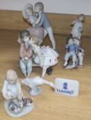 Three Lladro children, two Lladro children groups, a Lladro plaque and a goose (7)