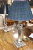 A silver-plated table lamp, with fluted tapered column and urn top and a similar table lamp