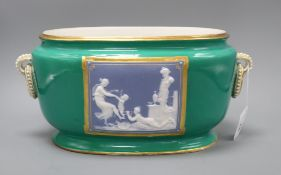 A 19th century green ground oval jardiniere with jasperware plaques of classical scenes, faint